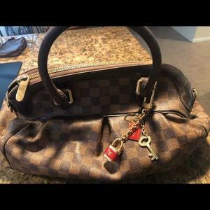 Louis Vuitton purse with 3 jewelry pieces